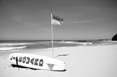 Surf Lifesaving flags and rescue board on Central Coast Beaches